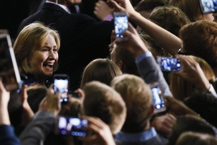 Former U.S. Secretary of State Hillary Rodham Clinton greets supporters at a rally for U.S. Senate candidate Gary Peters and gubernatorial candidate Mark Schauer at Oakland University in Auburn Hills, Mich. on Oct. 16, 2014.