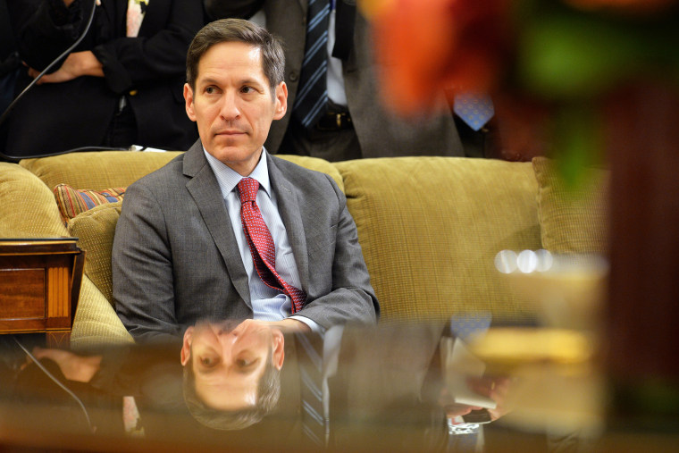 Dr. Thomas Frieden, director of the Centers for Disease Control and Prevention listens as President Barack Obama addresses the media in the Oval Office at the White House on Oct. 16, 2014 in Washington, DC. (Photo by Kevin Dietsch/Pool/Getty)