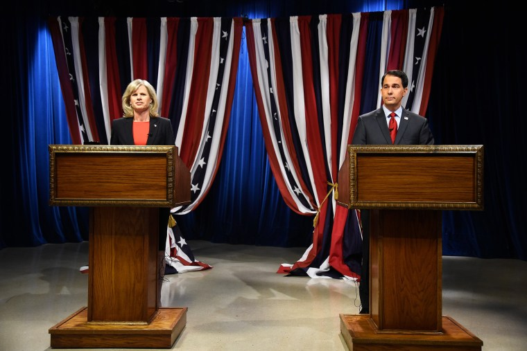 Wisconsin Republican Governor Scott Walker, right, and Democratic challenger Mary Burke, left, prepare for a televised debate on Oct. 17, 2014 in Milwaukee, Wis.