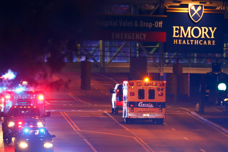 Ebola patient Amber Vinson arrives by ambulance at Emory University Hospital on Oct. 15, 2014 in Atlanta, Ga. (Photo by Kevin C. Cox/Getty)