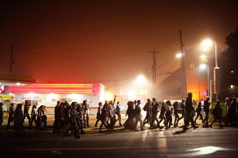 Demonstrators march through the street on Oct. 13, 2014 in St Louis, Mo. (Photo by Scott Olson/Getty)