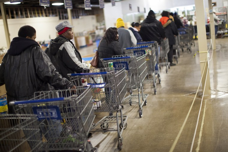 Clients wait in line to shop for food at St. Vincent de Paul food pantry in Indianapolis