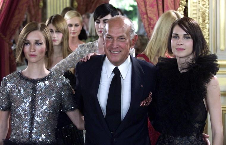 US designer Oscar de la Renta arrives at the end of the presentation of French fashion house Balmain..