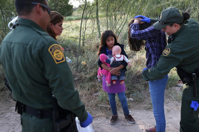 Salvadorian immigrant Stefany Marjorie, 8, watches as a Border Patrol agents body-searches her sister on July 24, 2014 in Mission, Texas.