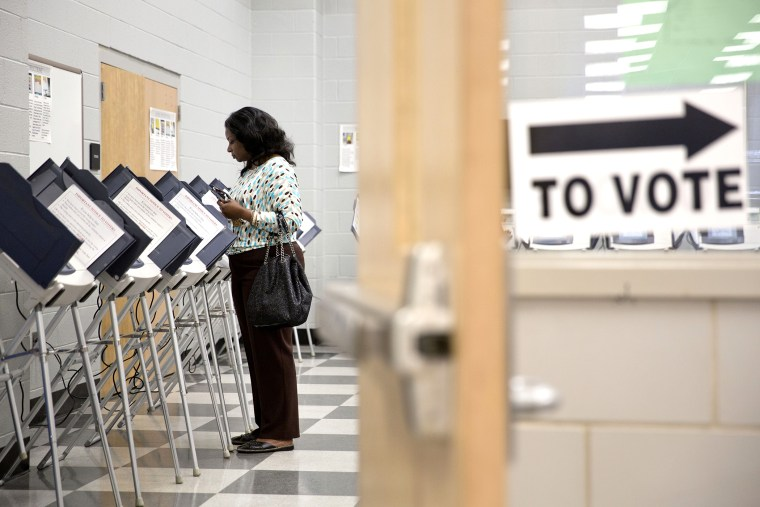A voter casts her ballot at a polling site during early voting for Georgia's primary election in Atlanta on May, 16, 2014.