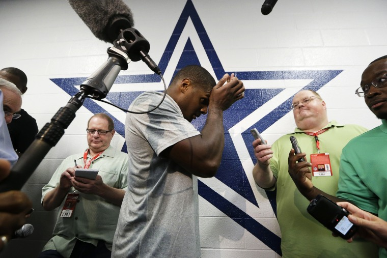 Dallas Cowboys practice squad player defensive end Michael Sam arrives to speak to reporters after team practice on Sept. 3, 2014, in Irving, Texas.