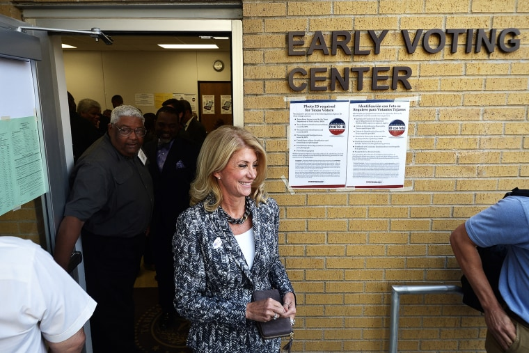 Wendy Davis exits the Early Voting Center after casting her vote on the first day of voting at the Charles Griffin Sub-Courthouse in Fort Worth, Texas on Oct. 20, 2014.