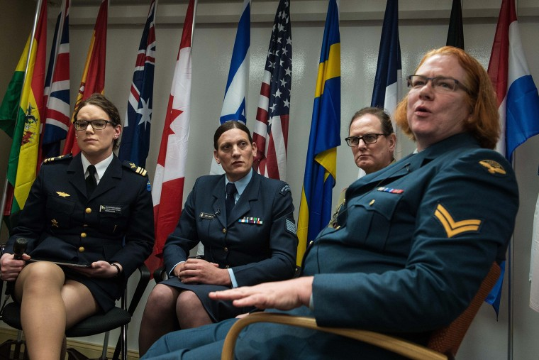From left, transgender people Major Alexandra Larsson of the Swedish Armed Forces, Sergeant Lucy Jordan of the New Zealand Air Force and Major Donna Harding of the Royal Australian Army Nursing Corps listen to Corporal Natalie Murray of the Canadian Force