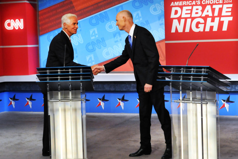 Democratic candidate Charlie Crist, left, and Republican Gov. Rick Scott shake hands before their live television debate on Oct. 21, 2014 in Jacksonville, Fla.