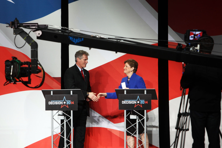 U.S. Sen. Jeanne Shaheen, right, shakes hands with Republican challenger Scott Brown on Oct. 21, 2014 in Concord, N.H.