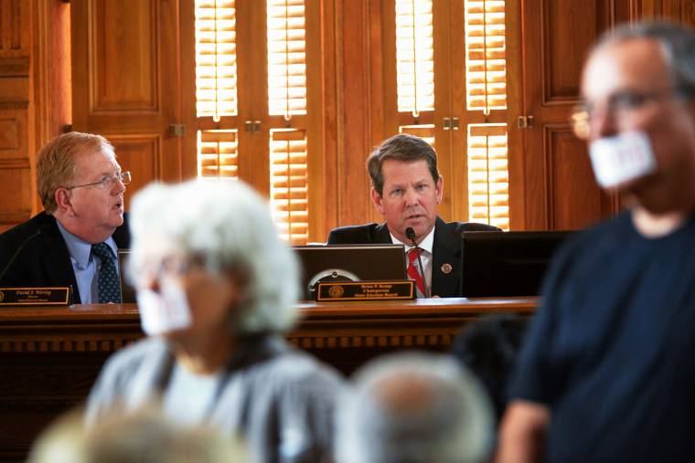 Brian Kemp, background right, Chairman of State Election Board, and David Worley, left, member of State Election Board, during a meeting to lay out the case of alleged voter registration fraud against the New Georgia Project at the Georgia State Capitol o