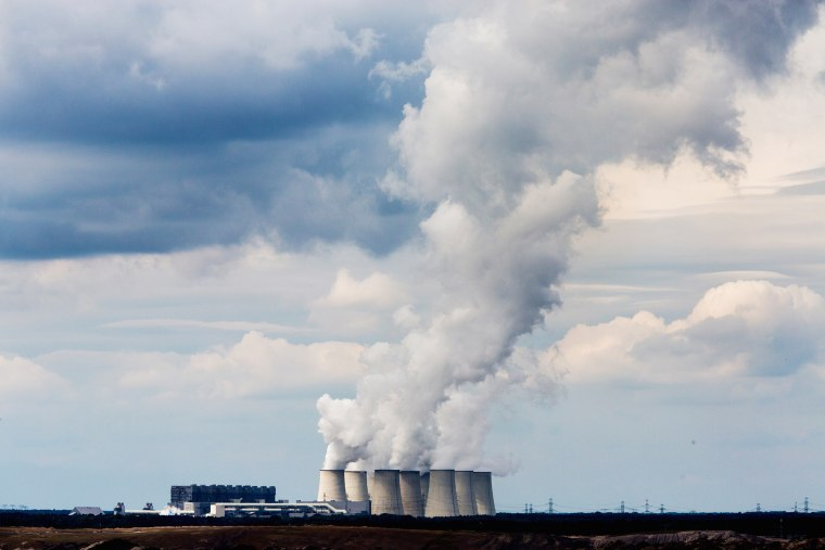 Steam rises from the cooling towers of the Jaenschwalde coal-fired power plant on Aug. 23, 2014 near Gross Gastrose, Germany.