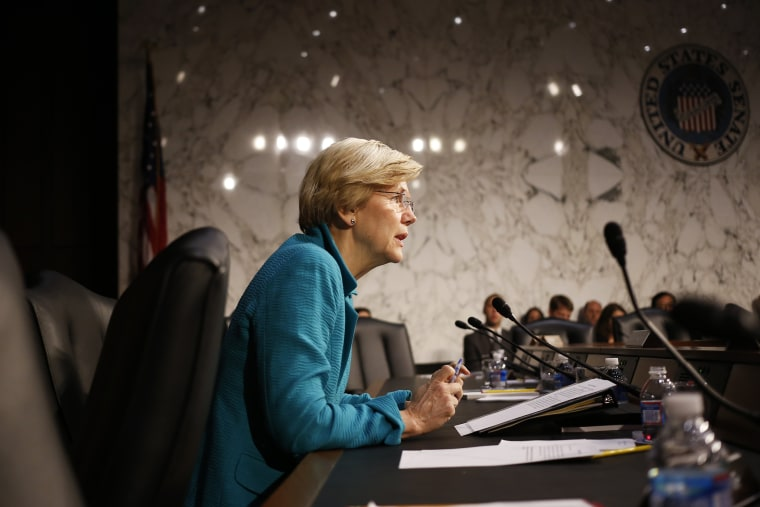Sen. Elizabeth Warren questions Treasury Secretary Jacob Lew as he testifies before the Senate Banking, Housing and Urban Affairs committee on Capitol Hill in Washington, D.C. on June 25, 2014.