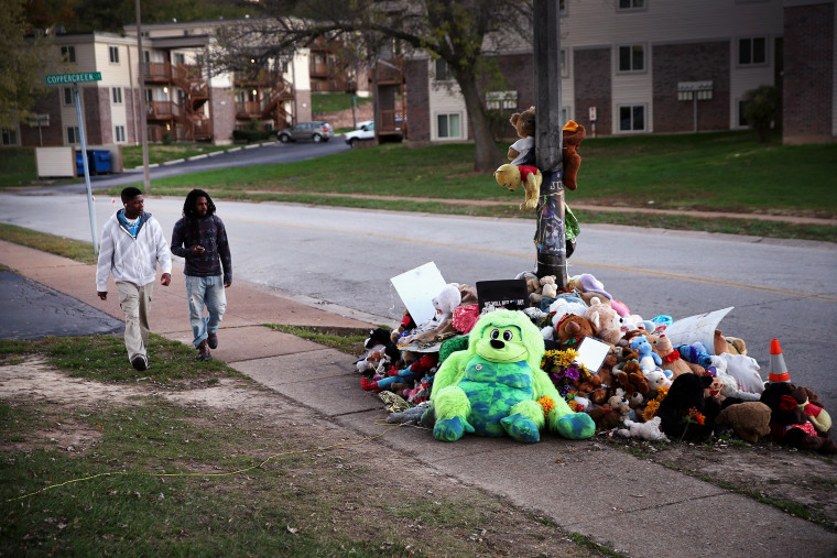 A memorial for 18-year-old Michael Brown remains on Canfield Street on Oct. 20, 2014 in Ferguson, Mo.