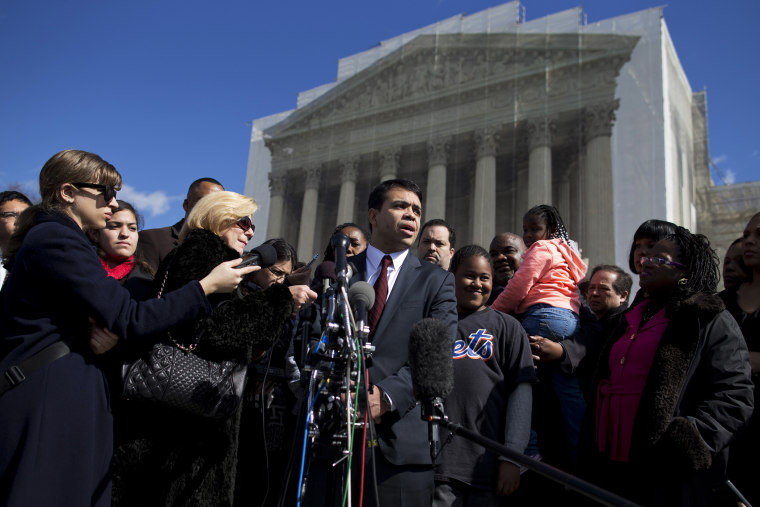 Debo Adegbile, special counsel, NAACP Legal Defense Fund, speaks with reporters outside the Supreme Court in Washington, D.C. on Feb. 27, 2013, after arguments in the Shelby County, Ala., v. Holder voting rights case.
