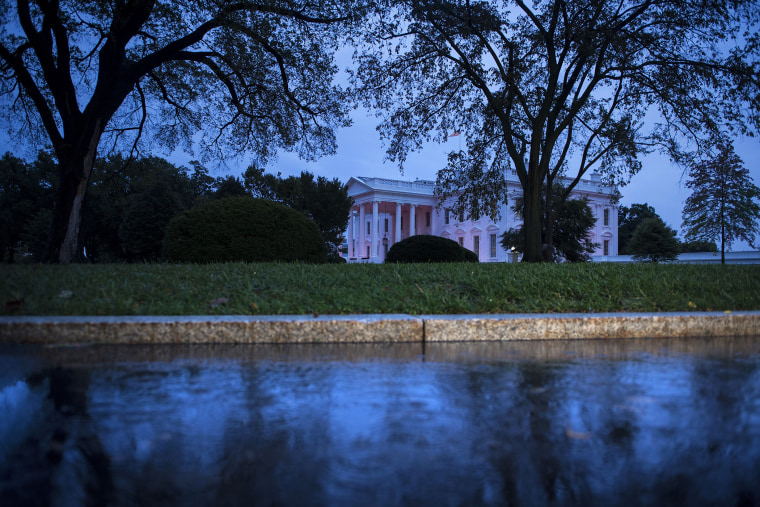 An evening view of the White House October 15, 2014 in Washington, D.C. (Photo by Brendan Smialowski/AFP/Getty)