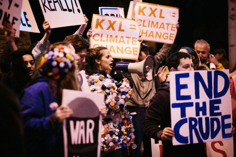 Protestors urge President Obama to reject the Keystone KXL Pipeline in Santa Monica, Calif. on Feb. 3, 2014. (Photo by Laura Kleinhenz/Redux)