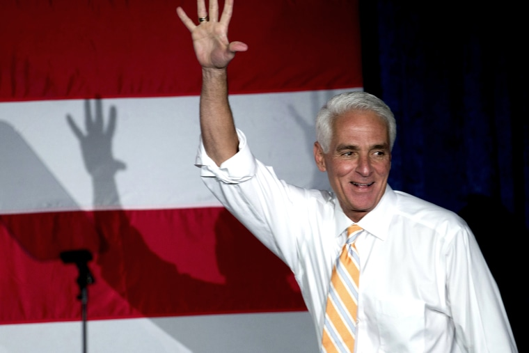 Former Florida Republican Gov. Charlie Crist, now running as a Democrat, waves to supporters during a campaign event, on Oct. 17, 2014, in Miami Gardens, Fla.