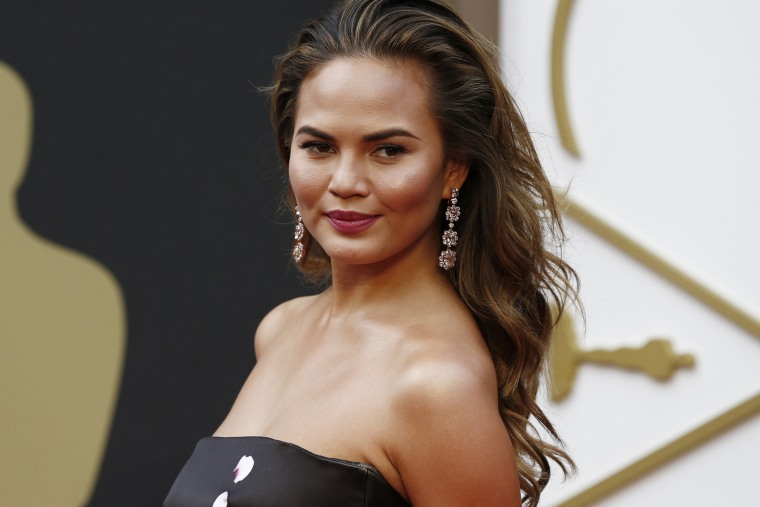 Model Chrissy Teigen arrives at the 86th Academy Awards in Hollywood, California on March 2, 2014.
