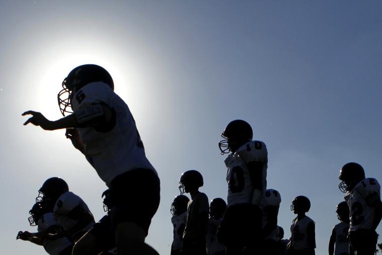 A high school football team at a practice.
