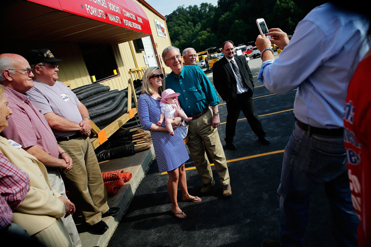 Senate Minority Leader Mitch McConnell (R-KY) poses for a photo while campaigning at a Rental Pro store during a two-day bus tour of eastern Kentucky on Aug. 7, 2014 in Hazard, Ky. (Photo by Win McNamee/Getty)