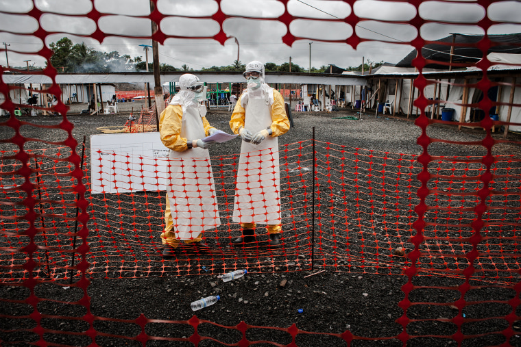 Doctors inside the high-risk area of the the Ebola Treatment Unit of Doctors without Borders in Monrovia, Liberia on Oct. 6th, 2014. (Photo by Daniel van Moll/Laif/Redux)