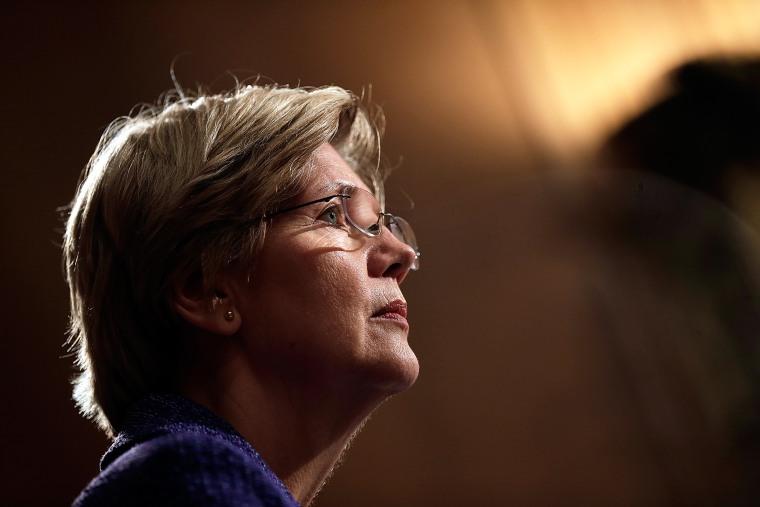 Sen. Elizabeth Warren (D-Mass.) listens during a hearing on Nov. 12, 2013 in Washington, D.C. (Photo by Win McNamee/Getty)