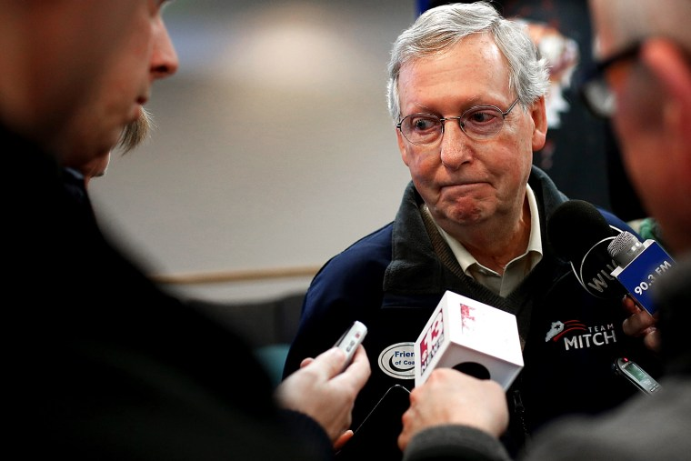 Senate Minority Leader Mitch McConnell (R-Ky.) answers questions from members of the press after speaking at a campaign rally Oct. 22, 2014 in Grayson, Ky. (Photo by Win McNamee/Getty)