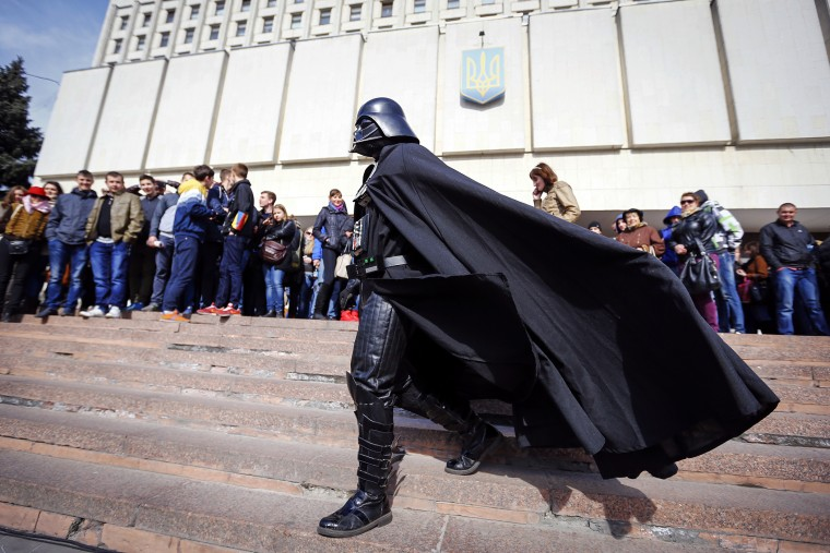 """Darth Vader"", the leader of the Internet Party of Ukraine, walks during a rally in front of the Ukrainian Central Elections Commission in Kiev April 3, 2014. (Photo by Shamil Zhumatov/Reuters)"