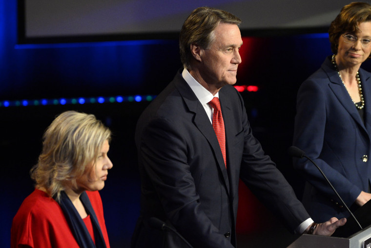 Georgia U.S. Senatorial candidates including Libertarian Amanda Swafford, left, Republican David Perdue, center, and Democrat Michelle Nunn, right, participate in a debate on Oct. 26, 2014, in Atlanta. (Photo by David Tulis/AP)
