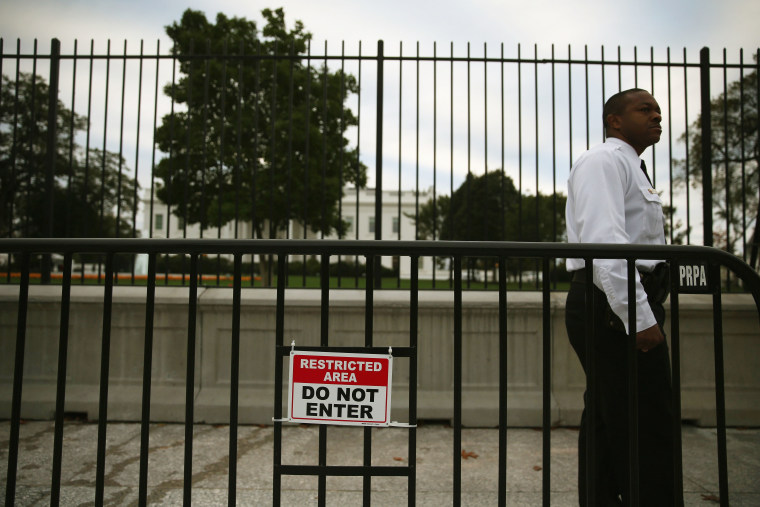 A member of the US Secret Service stands guard in front of White House Oct. 23, 2014 in Washington, DC.