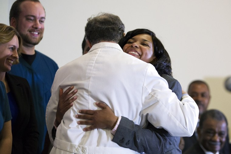 Amber Vinson, embraces Emory University Hospital epidemiologist Dr. Bruce Ribner, as she leaves a press conference after being discharged from the hospital, on Oct. 28, 2014, in Atlanta.