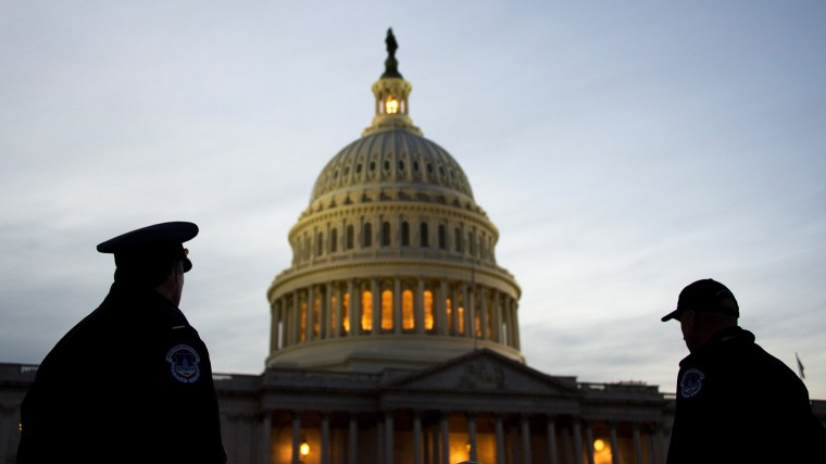 US Capitol Police stand guard in front of the US Capitol in Washington, DC, Feb. 12, 2013. (Photo by Jim Watson/AFP/Getty)