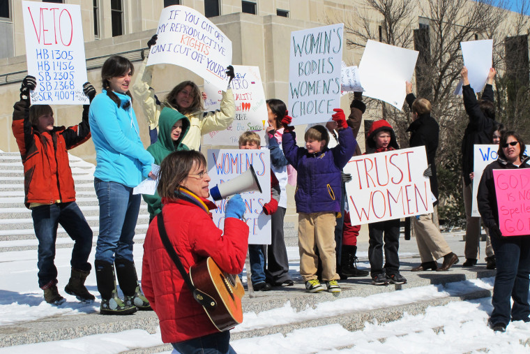 In this March 25, 2013, file photo Kris Kitko, left, leads chants of protest at an abortion-rights rally at the state Capitol in Bismarck, N.D. (Photo by James MacPherson/AP)