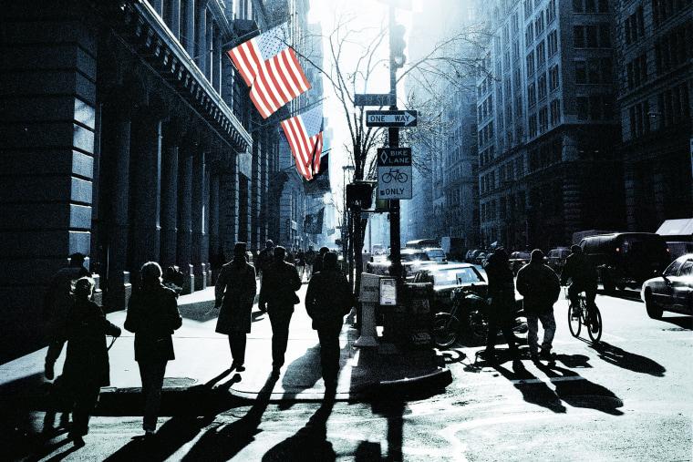 People walk down the street in New York.