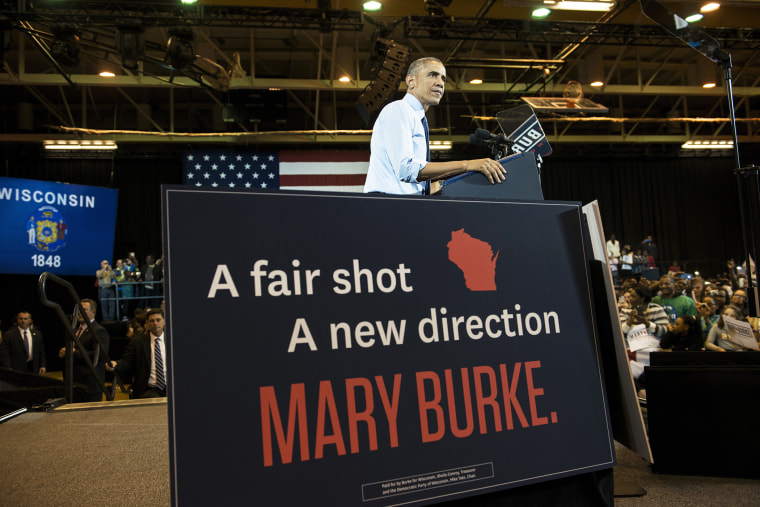US President Barack Obama speaks during a rally at North Division High School Oct. 28, 2014 in Milwaukee, Wisconsin. (Photo by Brendan Smialowski/AFP/Getty)
