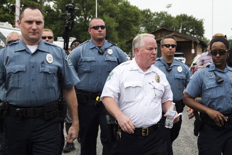 Ferguson Police Chief Thomas Jackson (C) walks away from a media availability in Ferguson, Mo on Aug. 15, 2014. (Photo by Lucas Jackson/Reuters)