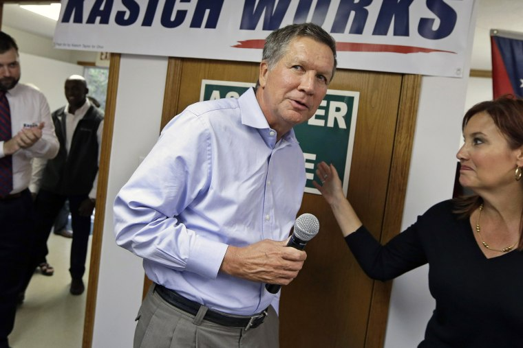 Ohio Gov. John Kasich is introduced by Lt. Gov. Mary Taylor during a rally at Darke County GOP headquarters, on Oct. 13, 2014, in Greenville, Ohio.