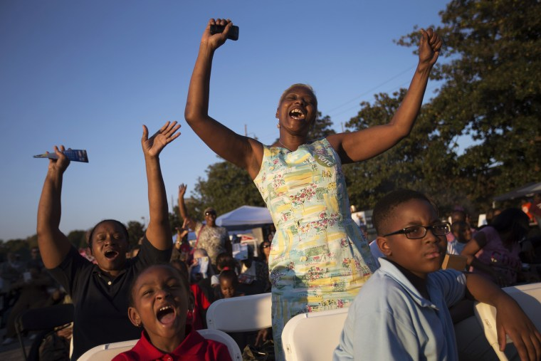 Priscilla Smith, left, and Sabrina Mobley, both of Decatur, Ga., dance before U.S. Senate candidate Michelle Nunn takes the stage, on Oct. 27, 2014, during a Democratic rally encouraging early voting in Decatur, Ga.