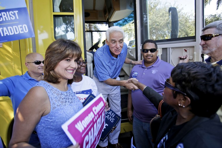 Florida Democratic gubernatorial candidate Charlie Crist, center, is greeted by supporters as he and his running mate Annette Taddeo-Goldstein, left, make a brief campaign stop on Oct. 25, 2014 in Fort Lauderdale, Fla.