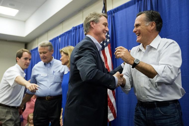 Former Republican presidential nominee Mitt Romney, right, embraces Georgia Republican U.S. Senate candidate David Perdue during a campaign event. on Oct. 29, 2014, in Augusta, Ga. (David Goldman/AP)