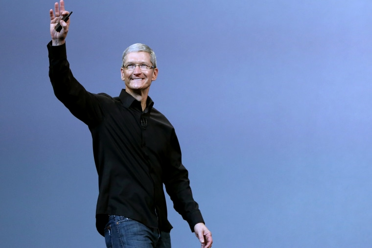 Apple Inc CEO Tim Cook steps out on stage during an Apple event in San Francisco, Calif. on Oct. 22, 2013.