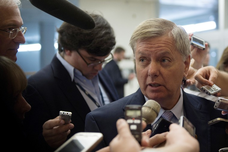 US Senator Lindsey Graham, R-SC, talks to reporters on Capitol Hill in Washington, DC on July 8, 2014.