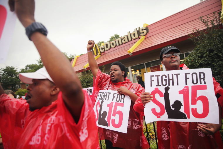 Demonstrators protest for an increase in wages for fast food and home care workers during the morning rush hour on Sept. 4, 2014 in Chicago, Illinois. (Photo by Scott Olson/Getty)