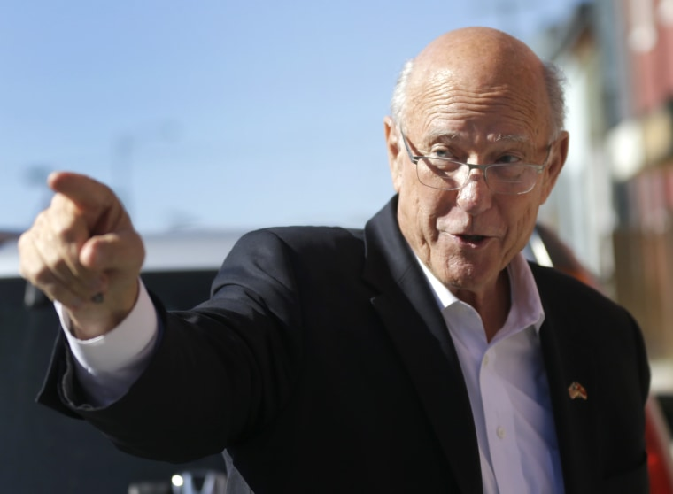 Sen. Pat Roberts, R-Kan., points to supporters during a campaign stop in Leavenworth, Kan., on Oct. 30, 2014.