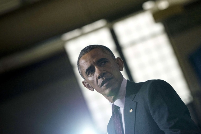 US President Barack Obama pauses while speaking at Rhode Island College Oct. 31, 2014 in Providence, Rhode Island.