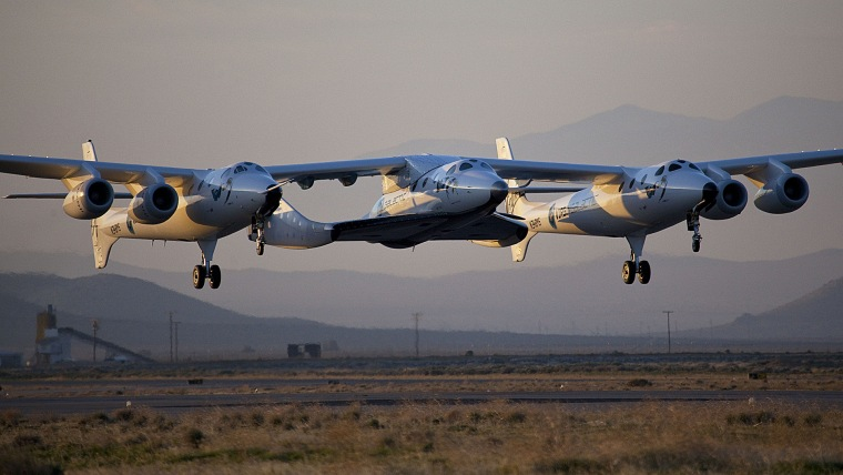 This photo released by Virgin Galactic shows the first captive-carry flight of VSS Enterprise or SpaceShipTwo over Mojave, Calif. on March 22, 2010. (Mark Greenberg/Virgin Galactic/AP)