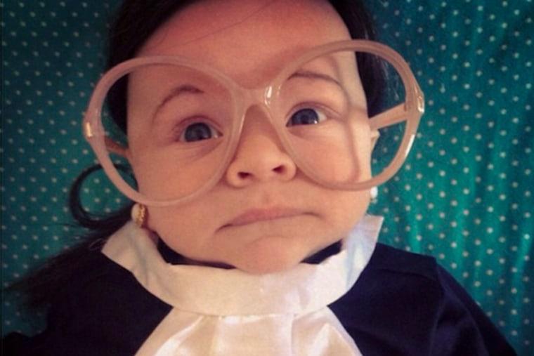 "Child dressed as Supreme Court Justice Ruth \""Baby\"" Ginsberg. (@taffyakner via twitter via NBC News)"