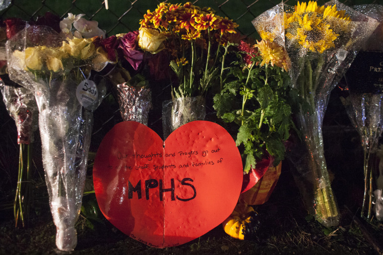 A memorial is pictured at Marysville-Pilchuck High School on Oct. 31, 2014 in Marysville, Wash. (Photo by David Ryder/Getty)