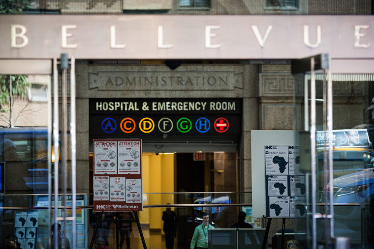 Signs regarding the ebola outbreak and treatment are posted at the entrance to Bellevue Hospital on Oct. 27, 2014 in New York, N.Y. (Photo by Andrew Burton/Getty)
